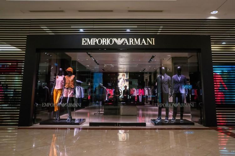shutterstock_408807805 Emporio Armani shop inside Suria KLCC. Emporio Armani is an Italian fashion house headquarters in Milan. Founded by Giorgio Armani since 1975., fashion, brand, apparel, clothes, store, style,